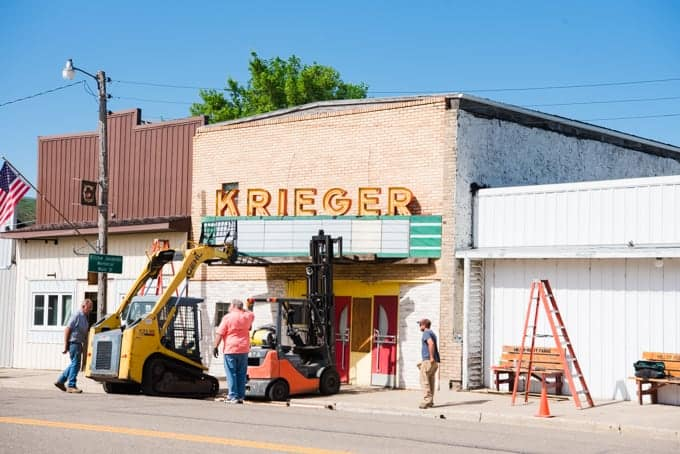 A movie theater marquee being removed.