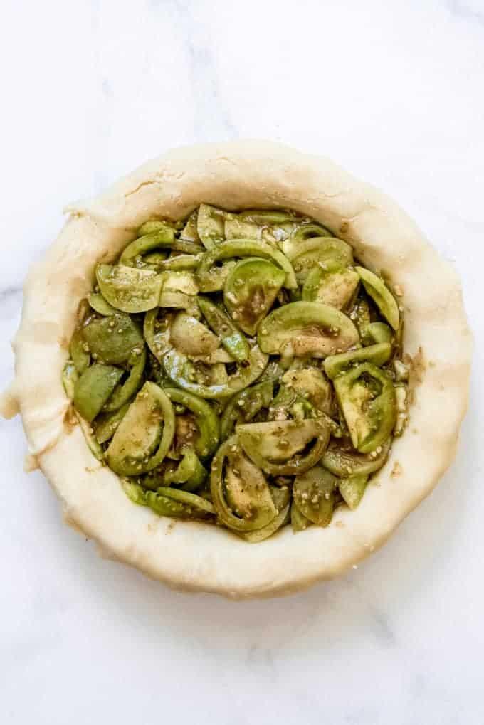 green tomatoes in a prepared bottom pie crust