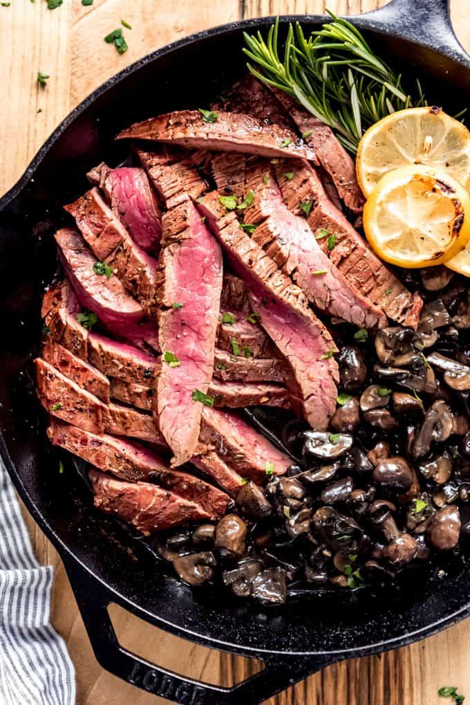 Medium-rare strips of grilled flank steak.