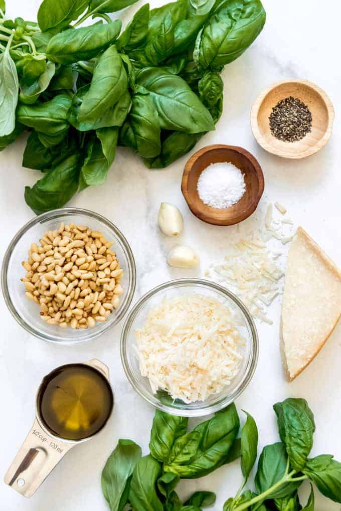 The ingredients for basil pesto assembled in individual bowls for easy preparation.