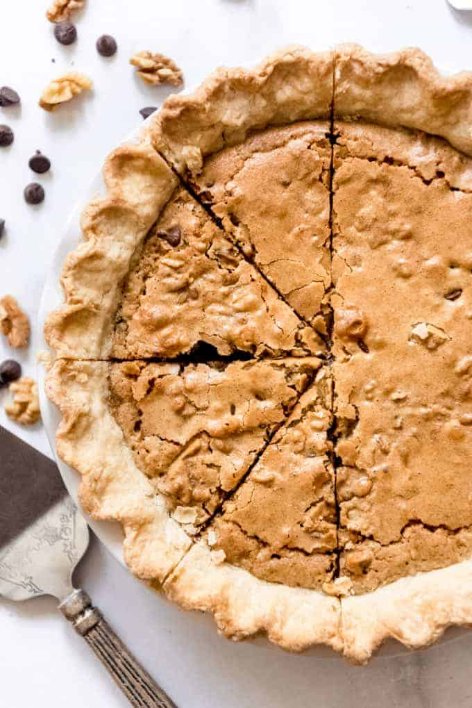 A Kentucky chocolate walnut pie with four slices cut into it.