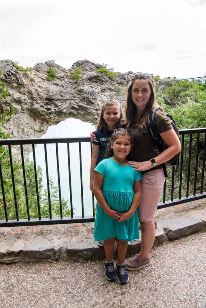 A mom and daughters at Arch Rock on Mackinac Island.