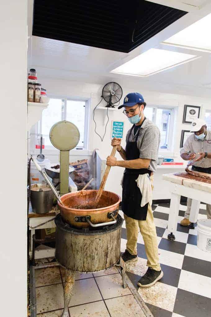 A man stirring a pot of fudge.