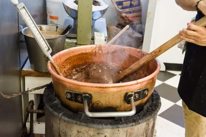 Hot fudge being cooked in a copper kettle.