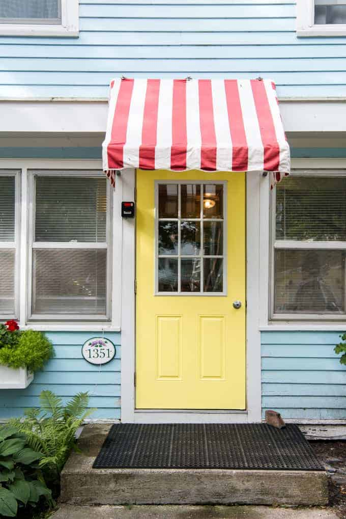 A yellow draw with a red and white striped awning.