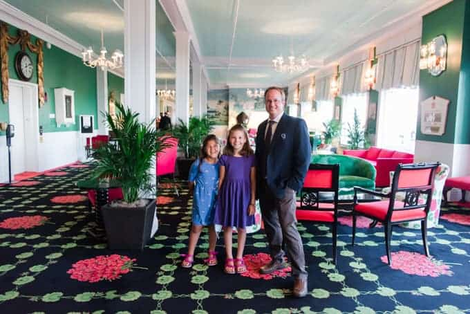 A man and his young daughters inside the Grand Hotel on Mackinac Island.