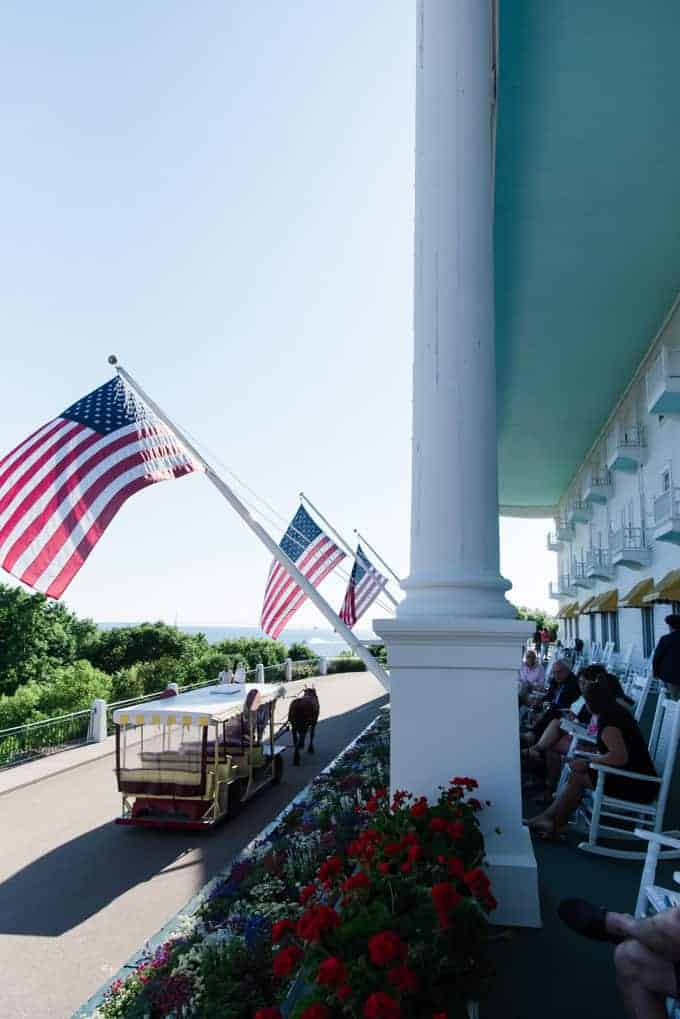 American flags waving from the porch of the Grand Hotel on Mackinac Island.