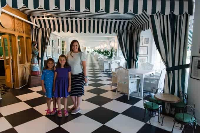 A mom and daughters in the Grand Hotel.