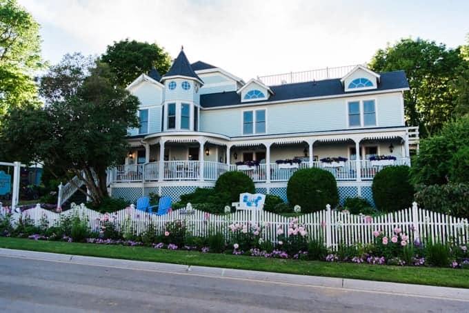 A blue Victorian-era home.