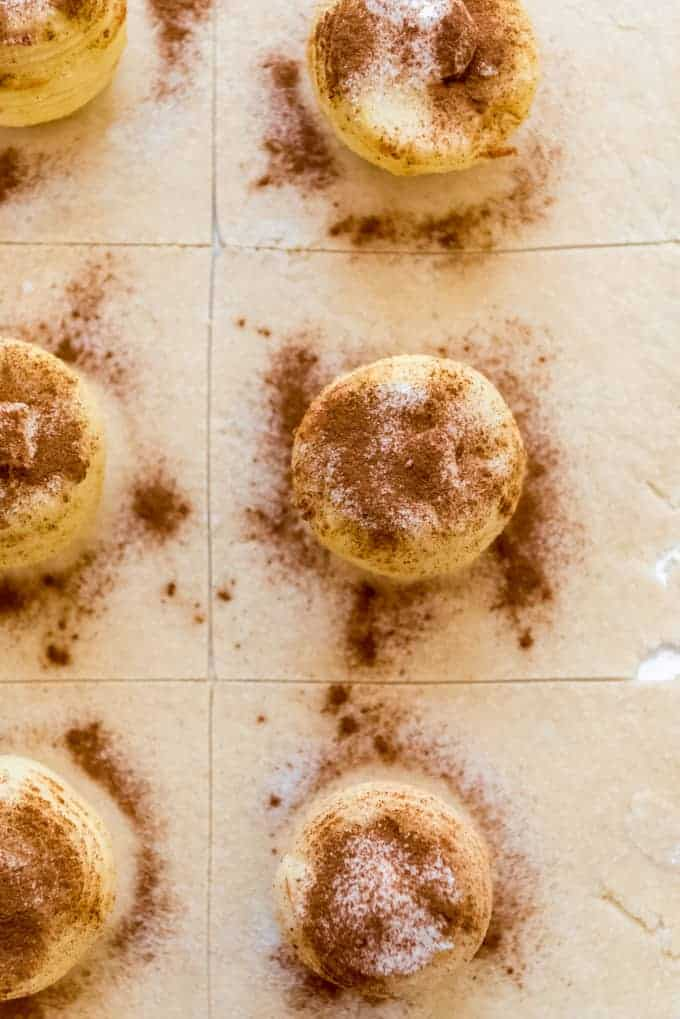 Apples sprinkled with cinnamon and sugar on pastry dough.