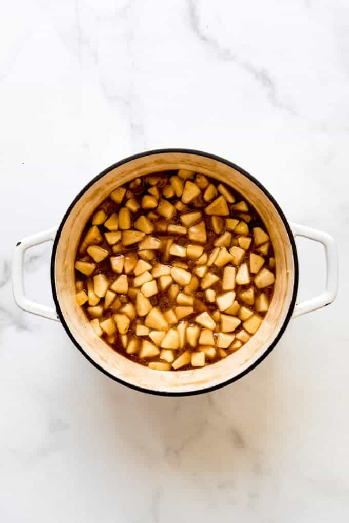 A large pot filled with apple pie filling.