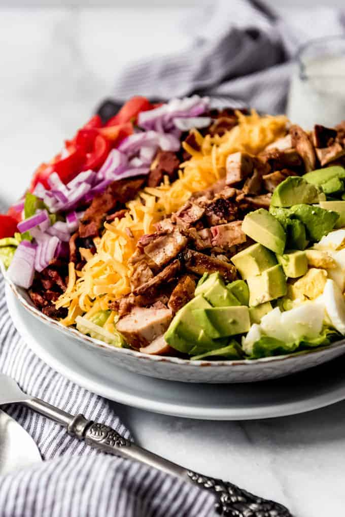 A side view of a grilled chicken cobb salad.
