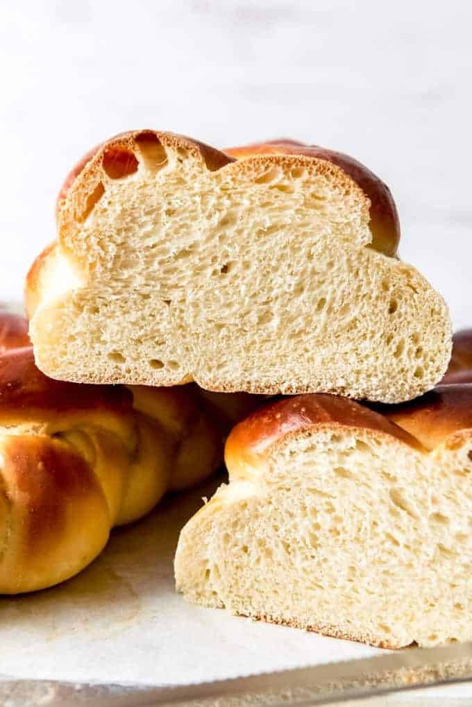 A close image of the texture of the inside of a loaf of braided challah bread.