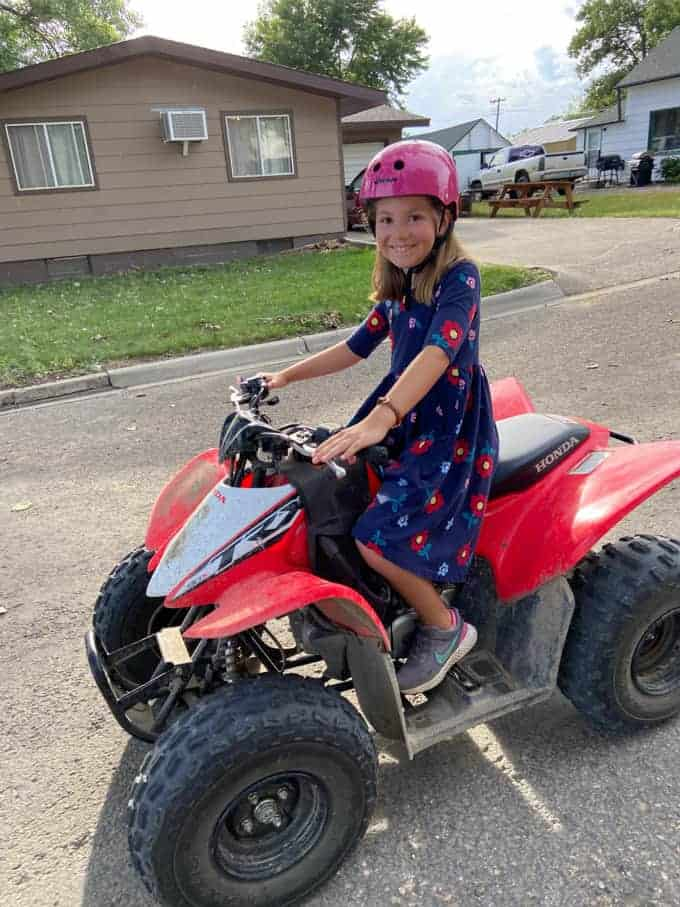 A girl on an ATV.