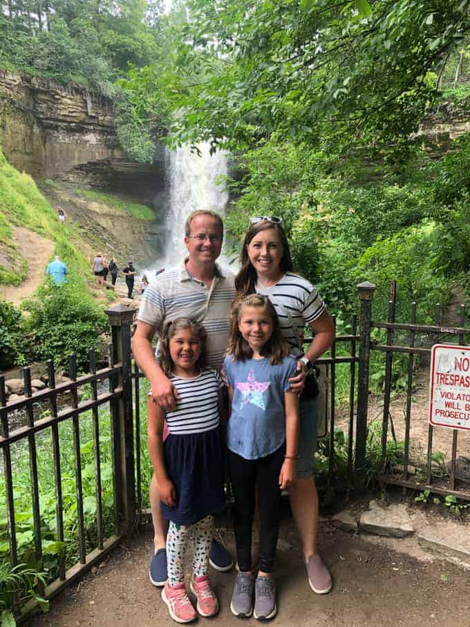 A family in front of Minnehaha Falls in Minneapolis, Minnesota.