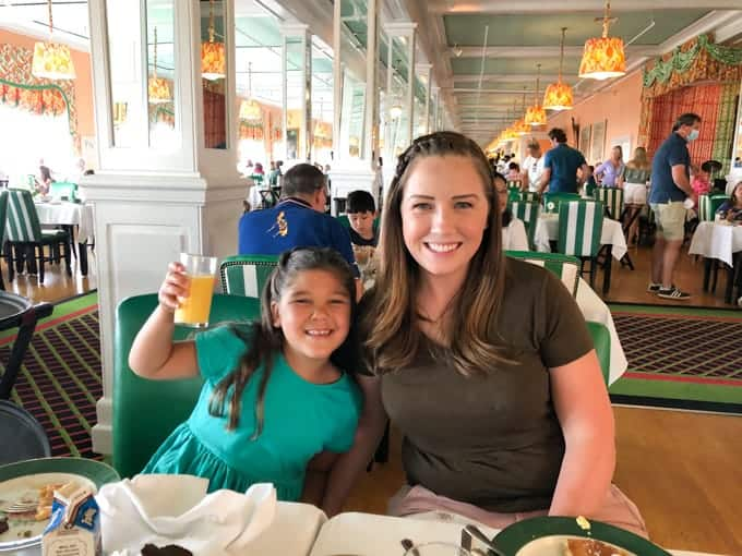 A mom and daughter eating breakfast in the Grand Hotel.
