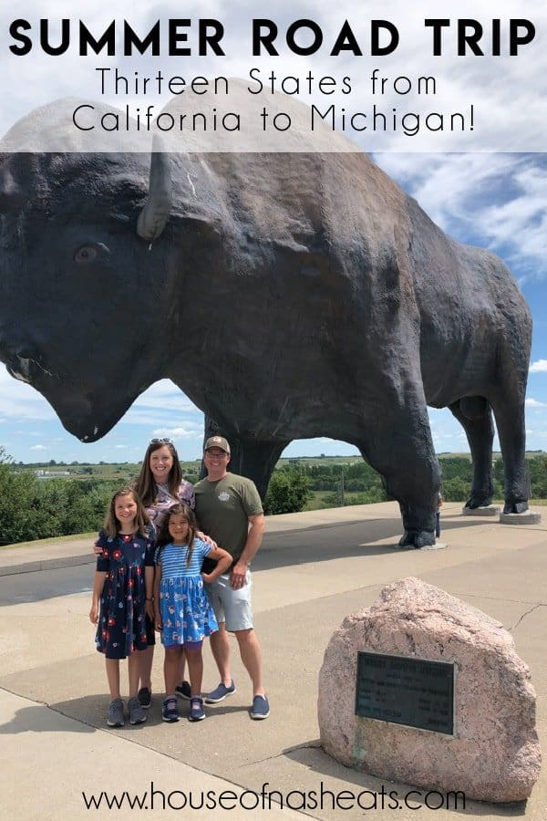 A mother, father, and two daughters in front of the world's largest buffalo statue in Jamestown, North Dakota.