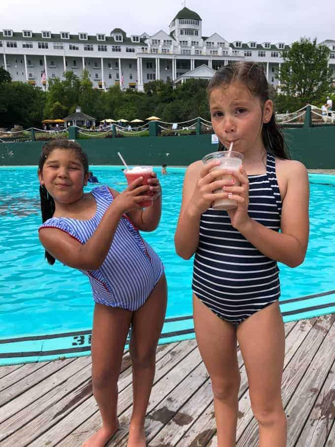 Kids enjoying tropical drinks by the pool on Mackinac Island.