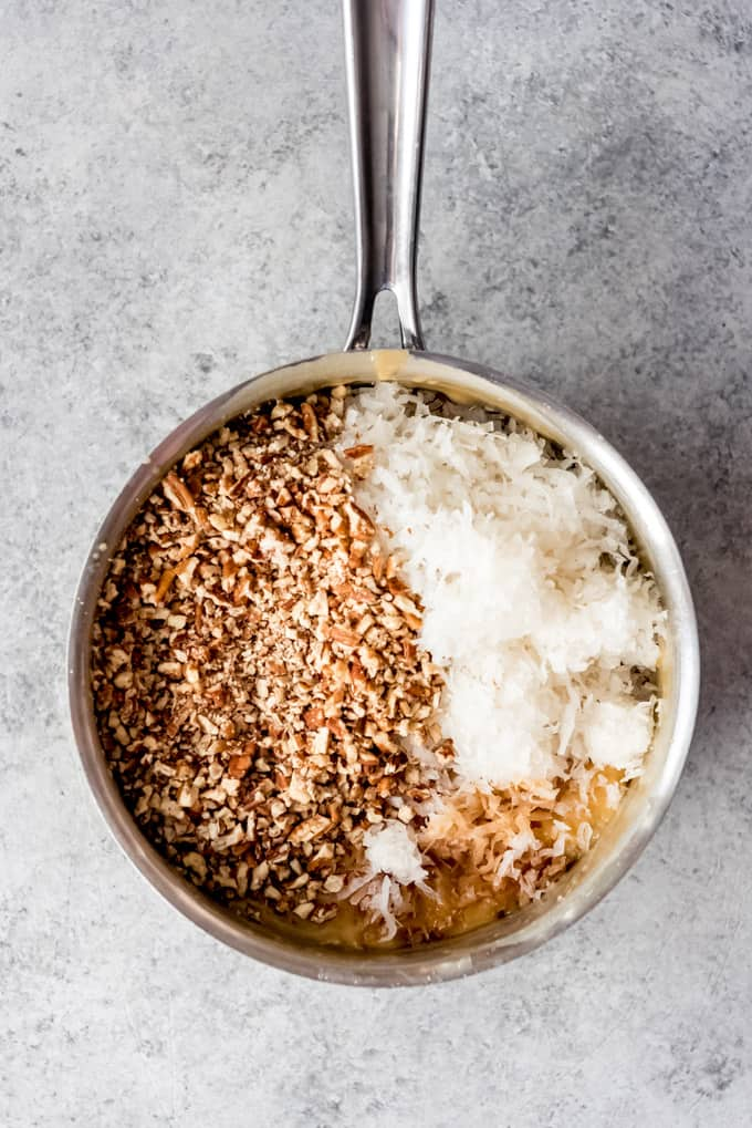 Coconut and pecans in a pot.