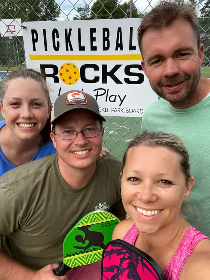 Friends at a pickleball court.
