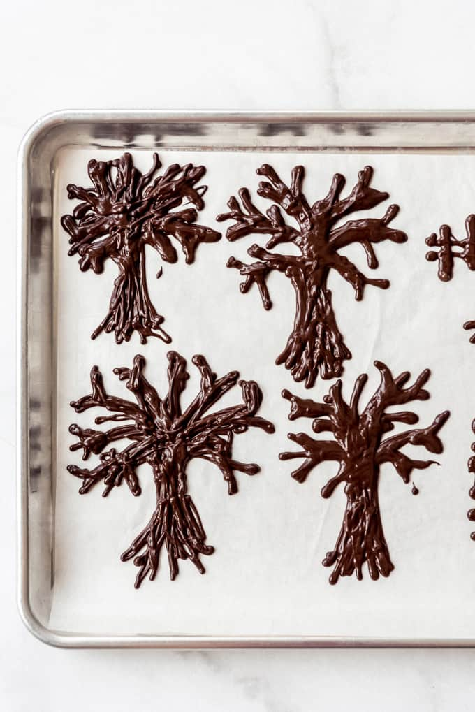 Chocolate trees on parchment paper.