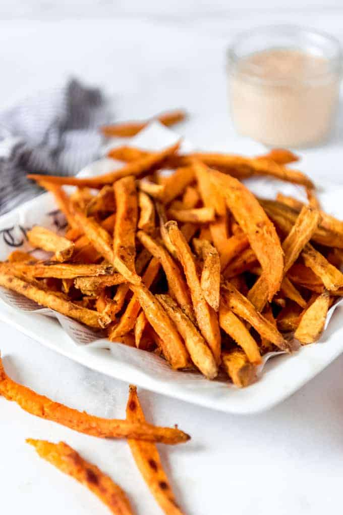 A pile of sweet potato fries on a plate.