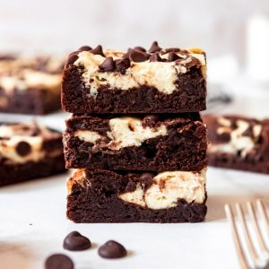 three stacked cream cheese brownies