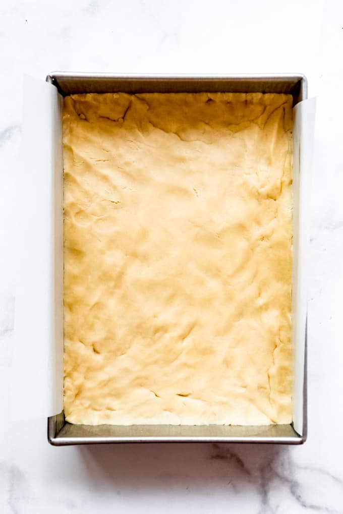 Sugar cookie dough pressed into a pan.