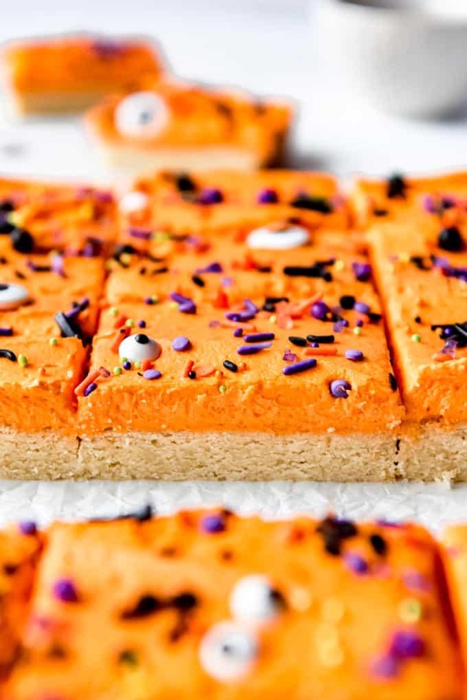 Sugar cookie bars with purple and black sprinkles.