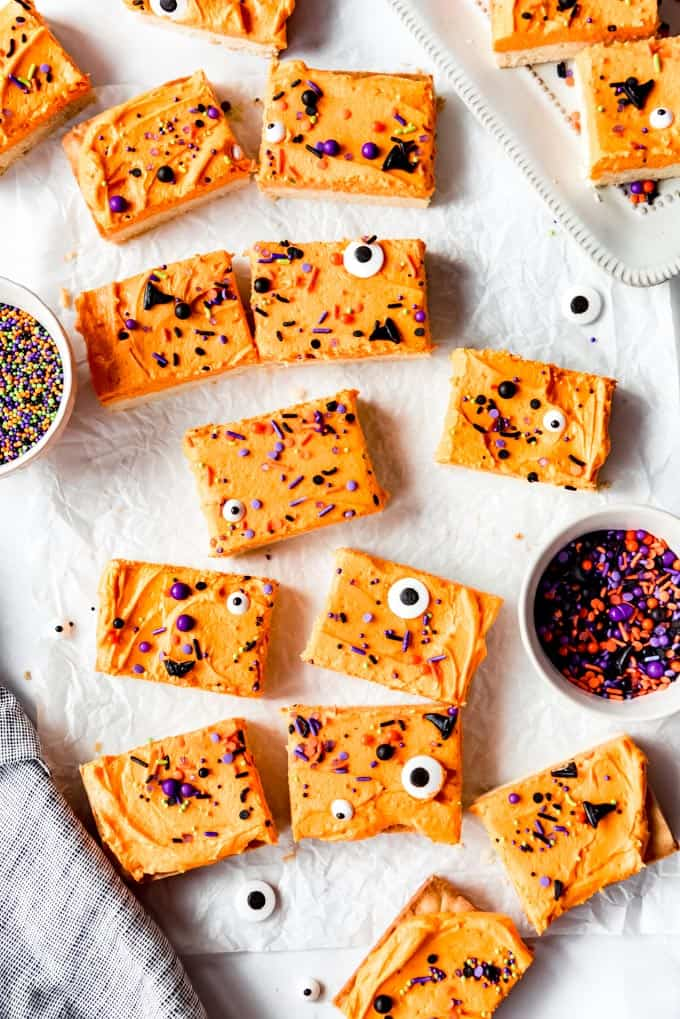 Cookie bars next to bowls of sprinkles.