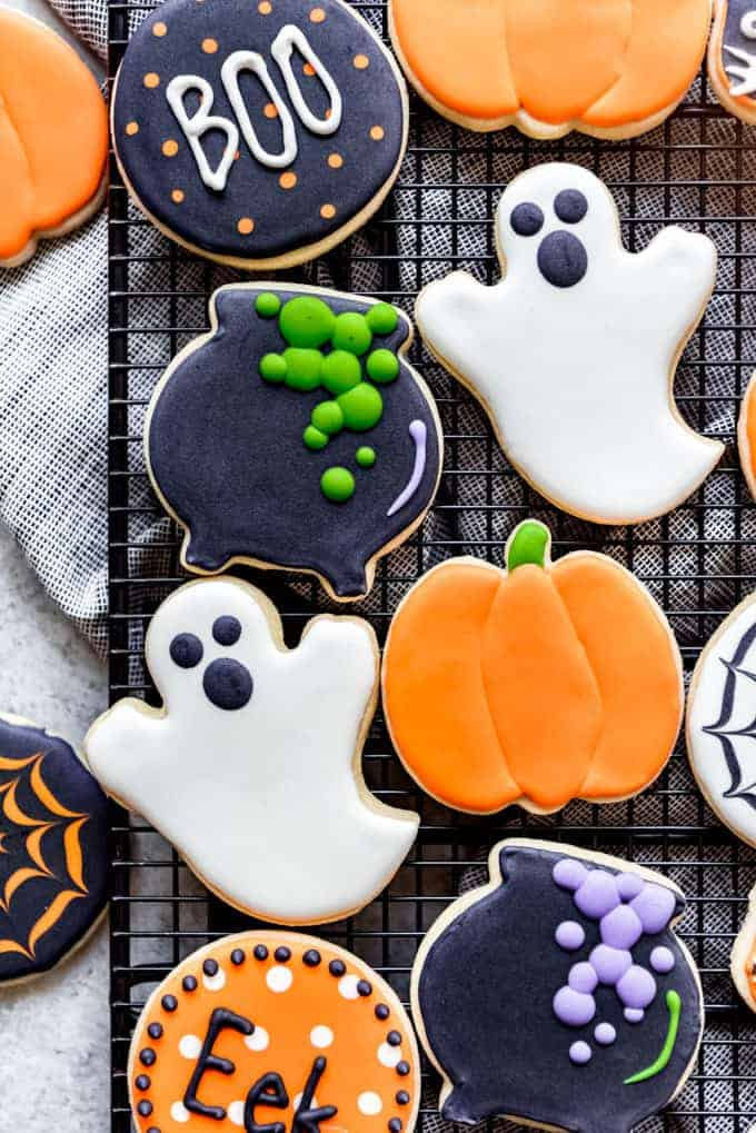 Sugar cookies decorated as cauldrons, ghosts, and pumpkins.