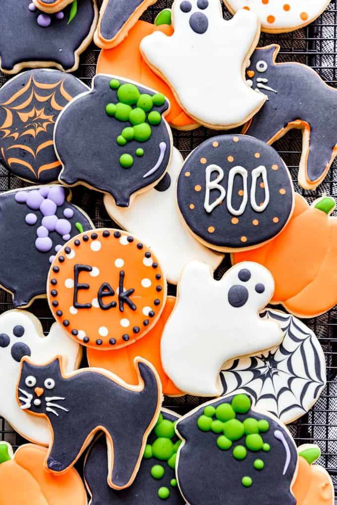 Cut-out sugar cookies decorated in Halloween designs.
