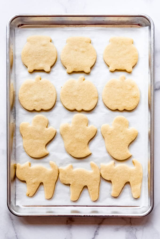 Baked sugar cookies on a baking sheet.