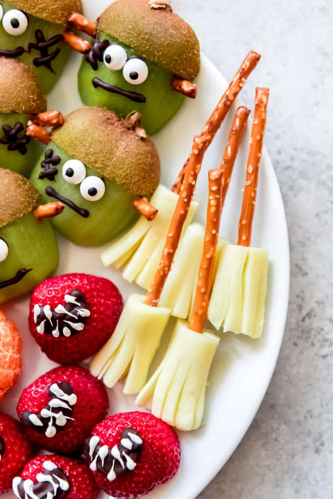 Witches broom snacks made from pretzels and string cheese.