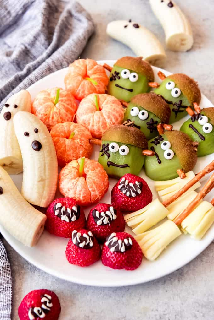 A plate of fruit decorated for healthy Halloween snacks.