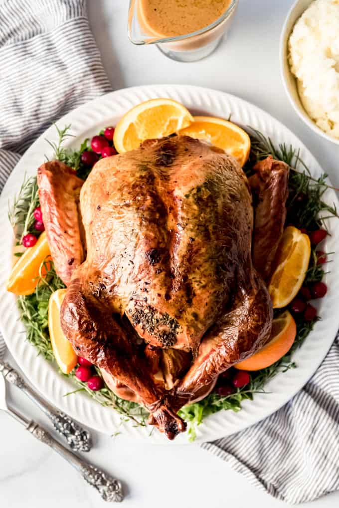 A whole herb roasted turkey with crispy skin.
