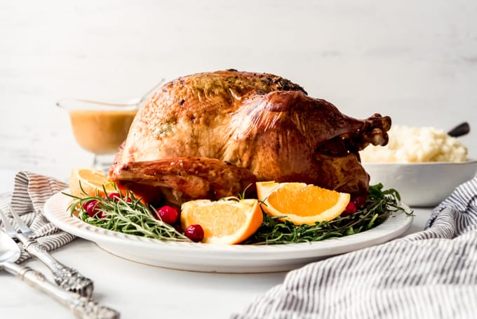 A roasted holiday turkey ready to be carved.