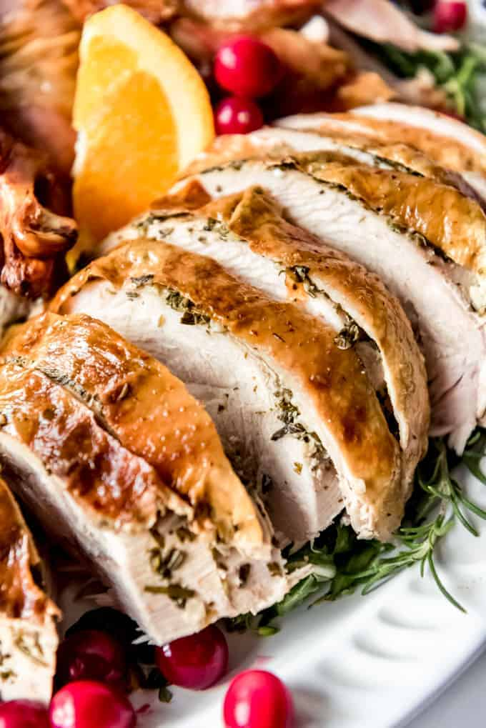 Thick slices of roast turkey breast on a platter.