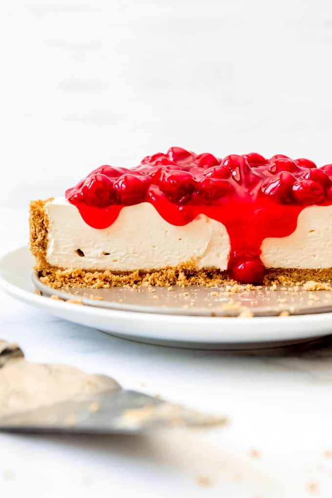 cut No-bake Cheesecake with cheery pie filling on top
