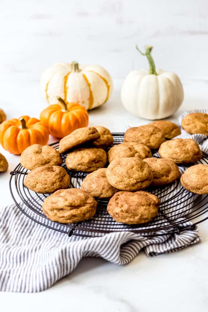 Pumpkin snickerdoodles on a wire cooling rack.