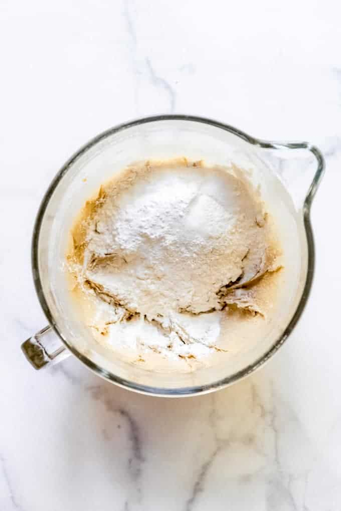 flour being added to cake batter