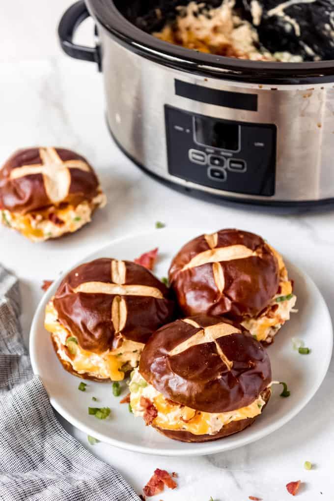 Slow cooker crack chicken on pretzel buns.
