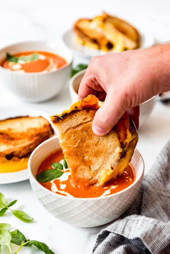Grilled cheese dipped into rich tomato soup