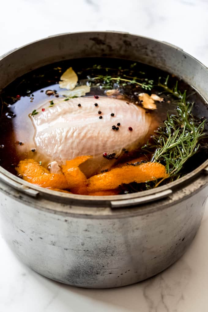 A turkey in brine in a pot.