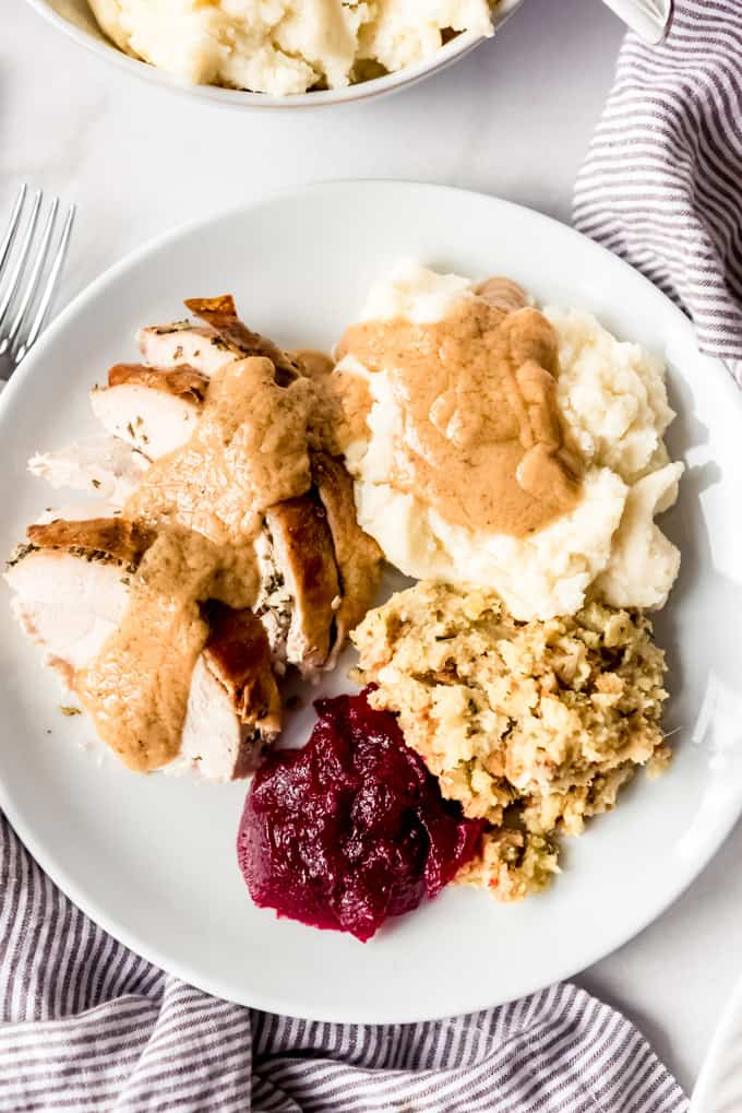 A plate with Thanksgiving dinner on it.