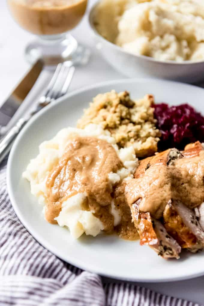 Mashed potatoes, turkey, and gravy on a plate.