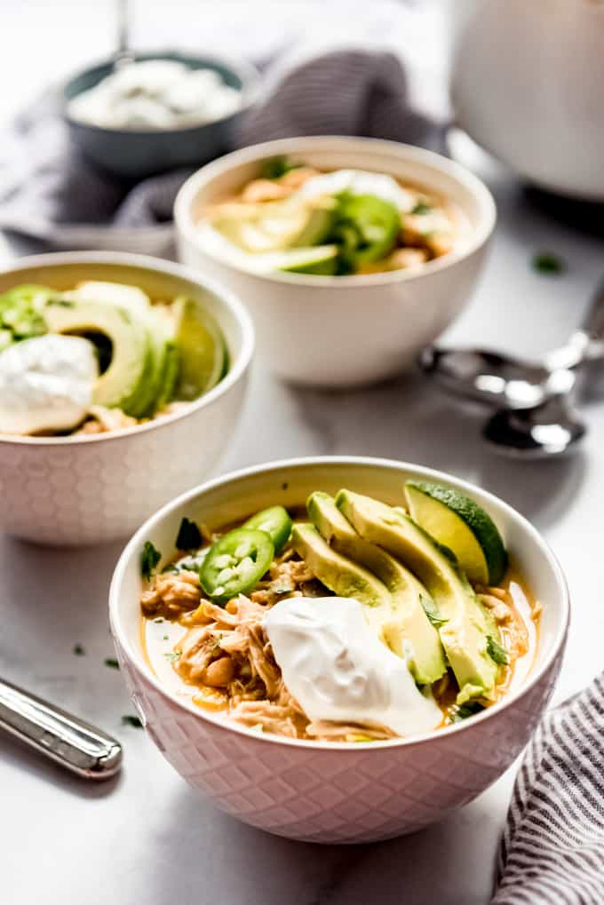 White bowls of Southwest White Chicken Chili.