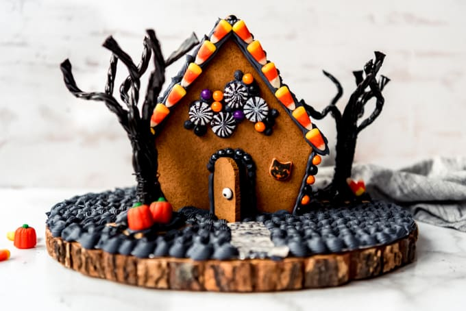 A gingerbread house decorated for Halloween.