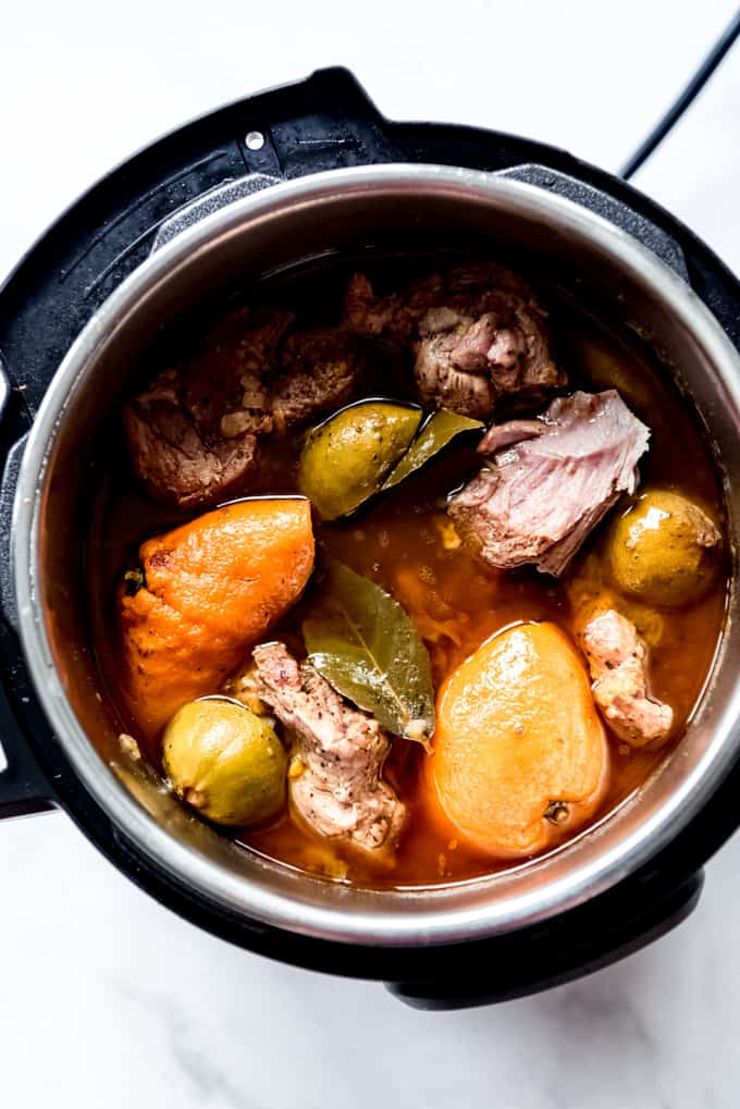Pork shoulder cooked in an instant pot with limes, oranges, and spices for Mexican carnitas.