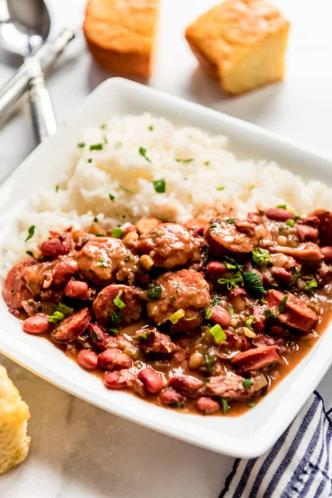 Square white plate of red beans and rice